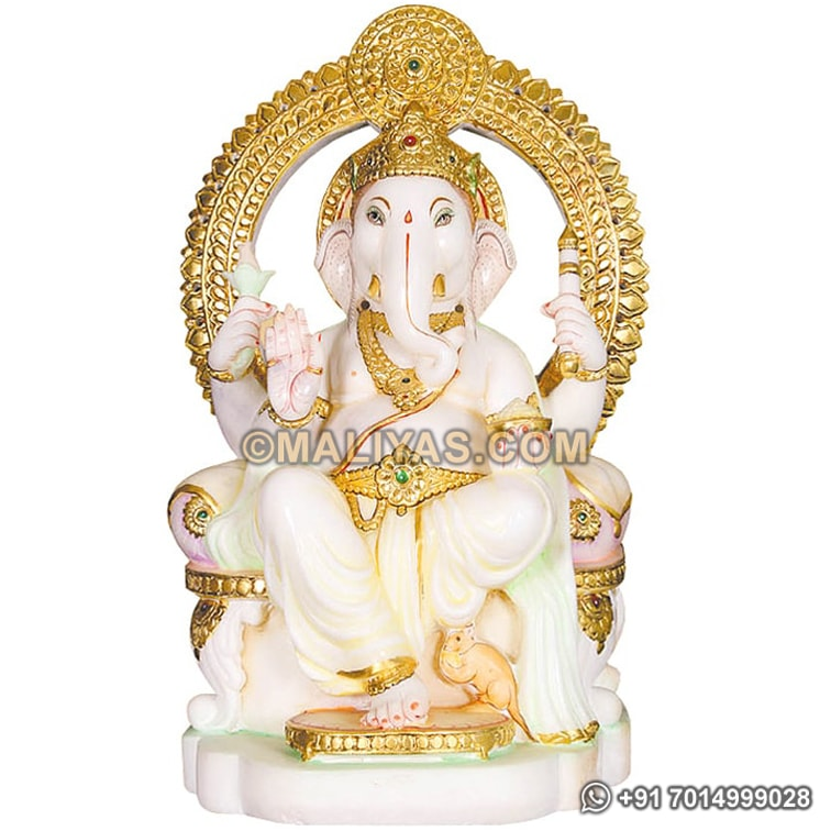 Marble ganesh sitting on singhasan