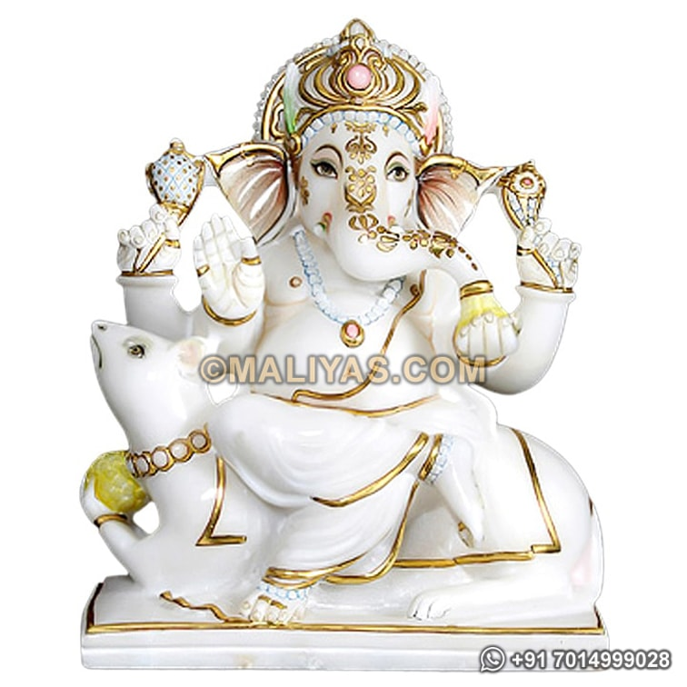 Marble ganesh statue sitting on mouse