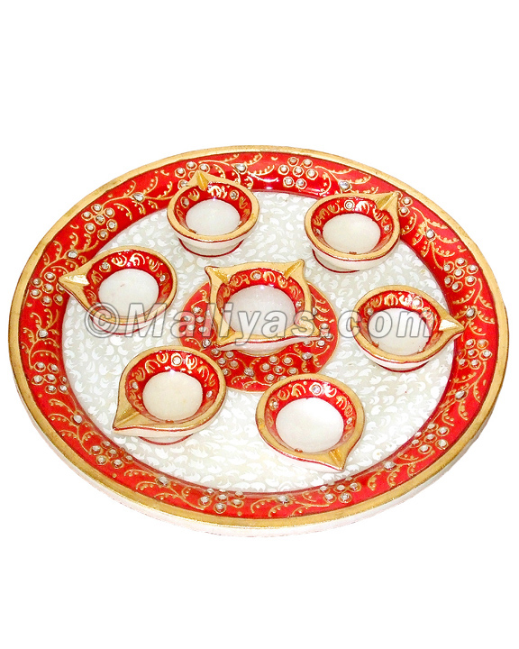 Gifting marble pooja thali with hand painting