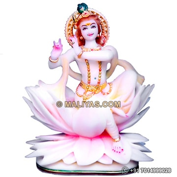 Marble Krishna statue on lots flower